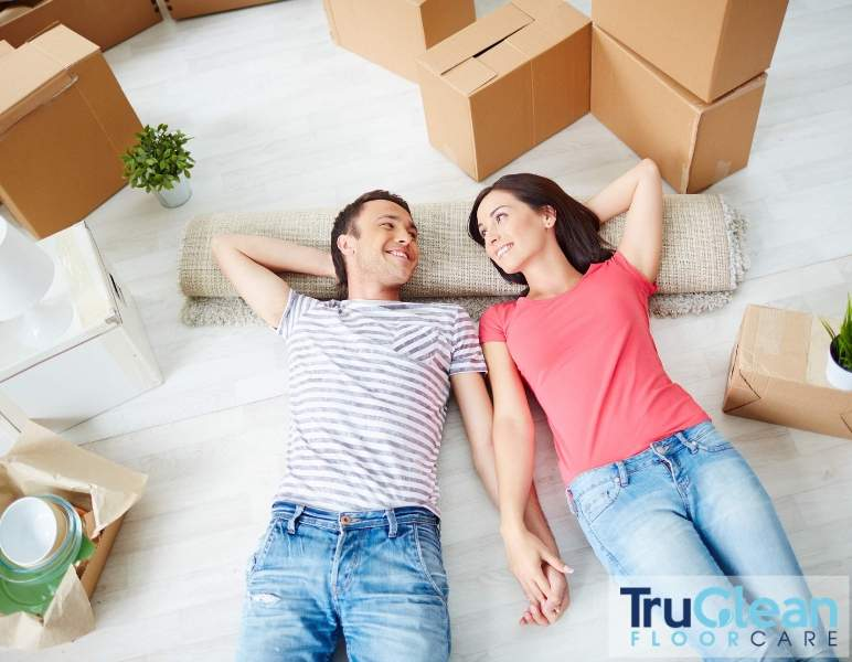 Move in, move out cleaning, couple laying on floor
